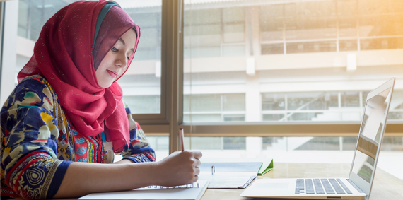 Young person studying in the library.